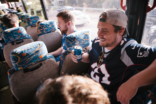pats fan enjoying a beer on the bus