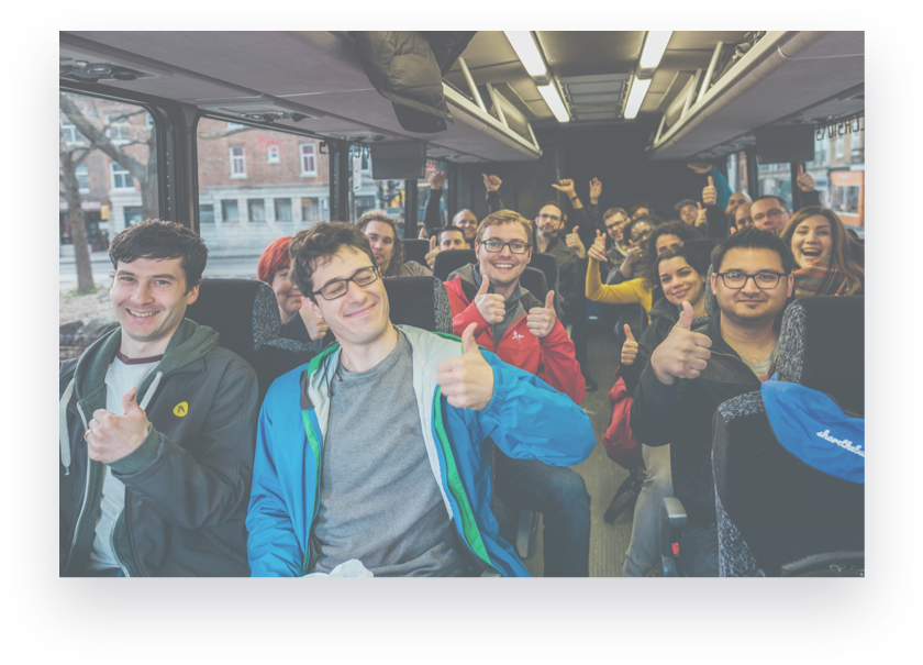 group of people cheering while riding in the bus