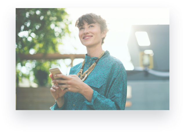 woman holding cellphone and smiling